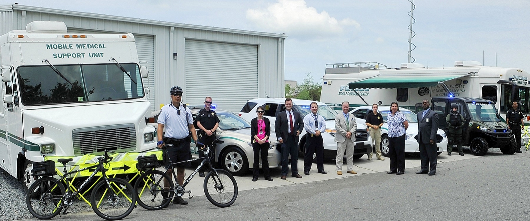 Police and Public Safety employees pose on campus with CALEA representatives.