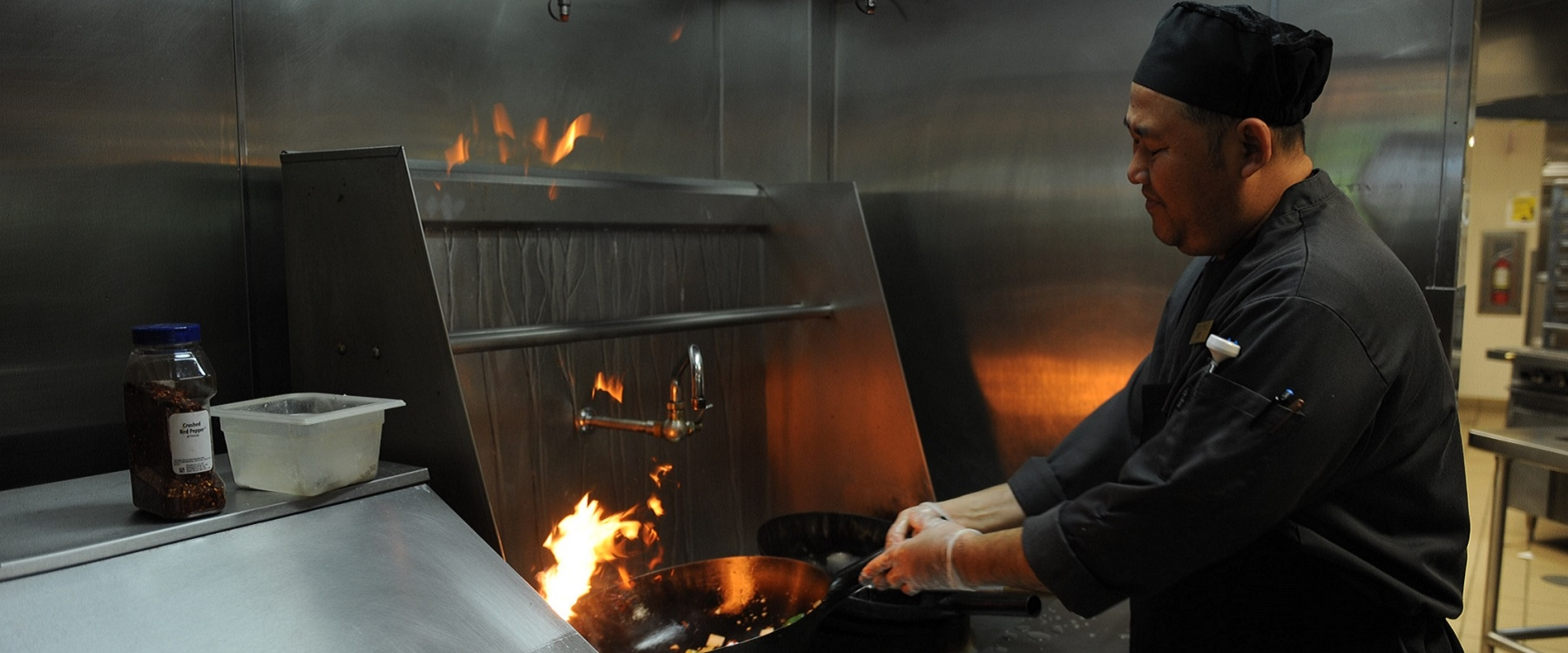 A chef prepares a meal on campus.