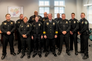Promoted officers stand with Chief Baker and Deputy Chief Huffman